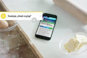 Michał Pol jako kucharz na spalonym reklamuje aplikację Onetu