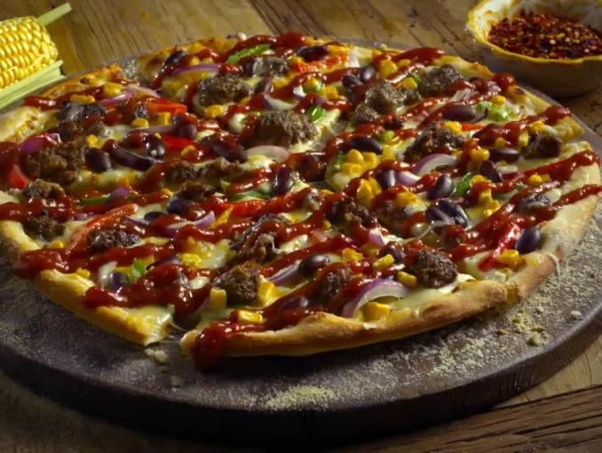 Domino's Pizza reklamuje pizzę Tex-Mex