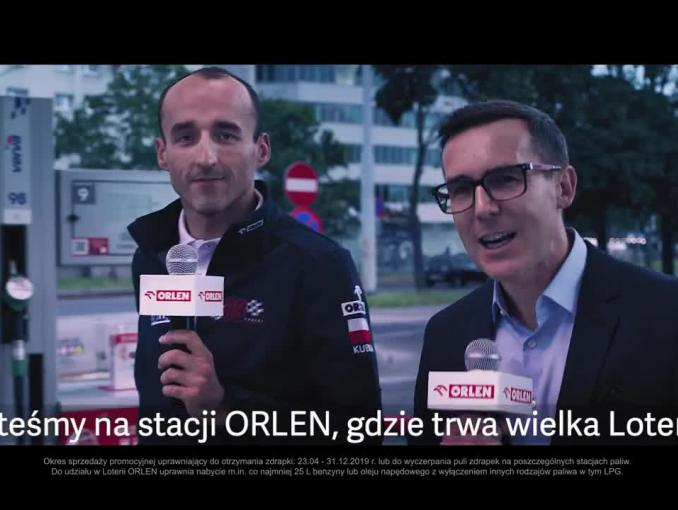 Robert Kubica z Maciejem Kurzajewskim reklamuje loterię Orlenu