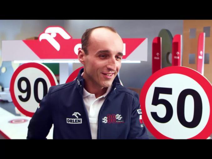 Robert Kubica z dziećmi edukuje w kampanii #DobryKierowca PKN Orlen - prędkość