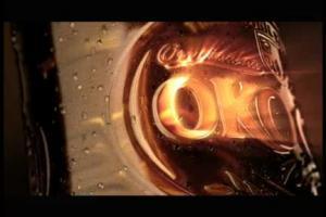 Okocim 'z przyjemnością' reklamuje zmienioną butelkę